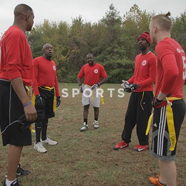 Church on the Rock Sports Ministry: a group of men playing flag football
