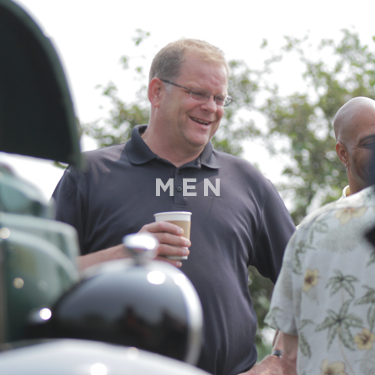 Church on the Rock Men's Ministry: men talk over coffee, their motorcycles in the foreground